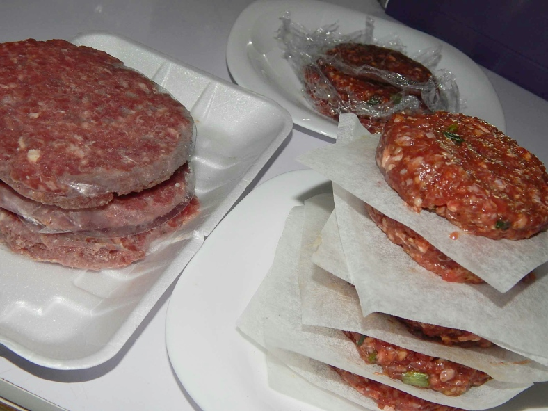 The stack of 3 on the left is the ready made burger meat,  while the stack on the right is our homemade one from minced meat
